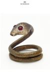 Un cobra en bronze pr�t � bondir pour enserrer votre gland et hypnotiser votre entourage.
