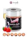 La chaleur du corps transforme la brazilian ball en liquide glissant au parfum fraise & champagne, votre imagination s'en trouve exacerb�e.