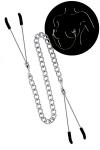 2 pinces � seins reli�es entre elles par une chainette en acier argent�, pour lui procurer de d�licieuses sensations.