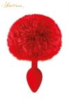 Un plug anal �l�gant et original avec son pompon rouge en fourrure synth�tique fix� � son extr�mit�.