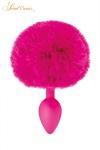 Un plug anal �l�gant et original avec son pompon fuchsia en fourrure synth�tique fix� � son extr�mit�.